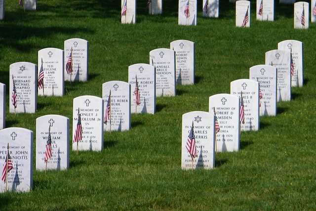"""Arlington National Cemetery. Photo Credit: """"Graves with flags"""" © 2012 by Alan Kotok (CC BY 2.0)"""