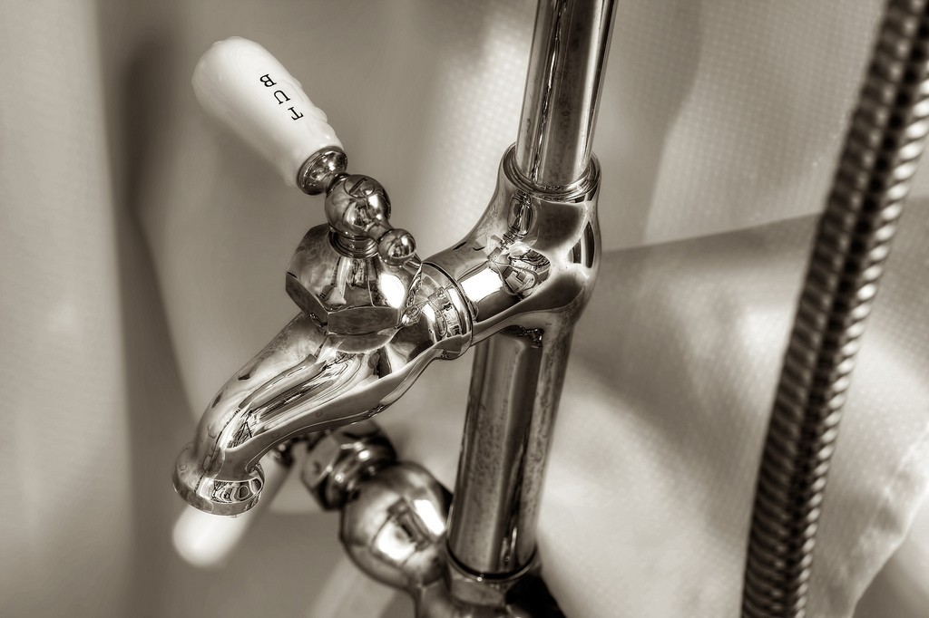Tub plumbing black and white