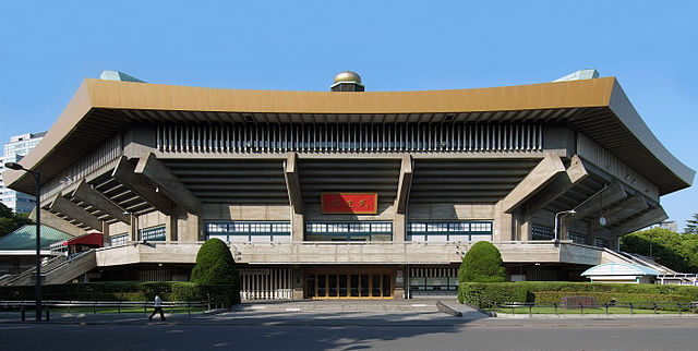 Nippon Budokan Hall Main entrance Wiiii - Own work Nippon Budokan, Chiyoda-ku Tokyo Japan, designed by Mamoru Yamada in 1964. © 2010 By Wiiii (Own work) [GFDL (http://www.gnu.org/copyleft/fdl.html) or CC BY-SA 3.0 (http://creativecommons.org/licenses/by-sa/3.0)], via Wikimedia Commons https://commons.wikimedia.org/wiki/File%3ANippon_Budokan_2010.jpg
