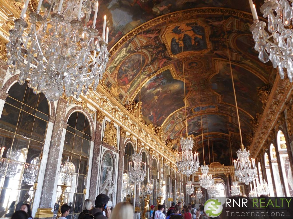 The Hall of Mirrors at Versailles. Tons of mirrors and tons of tourists.